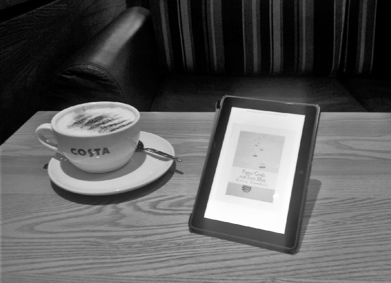Kindle, coffee, sofa.